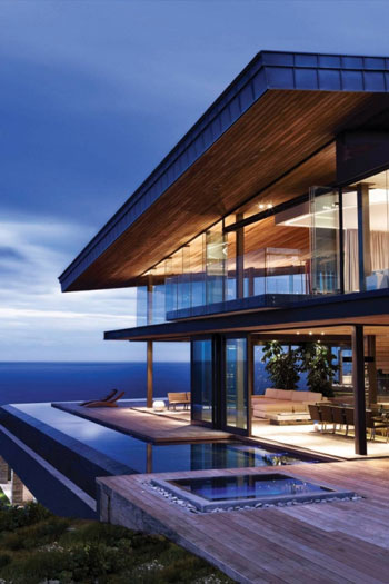 house with modern architecture build on the side of a cliff